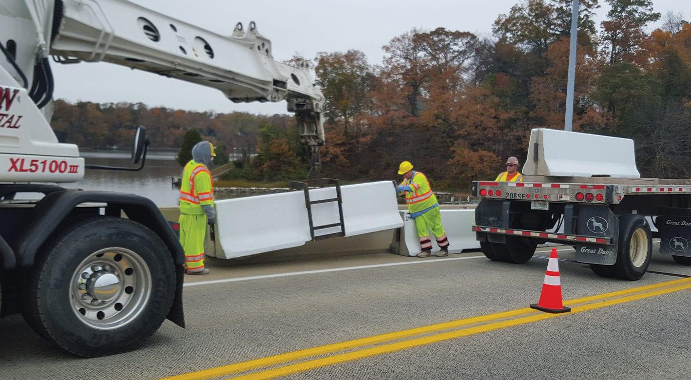 Installing J-J Hooks safety barriers on a roadway
